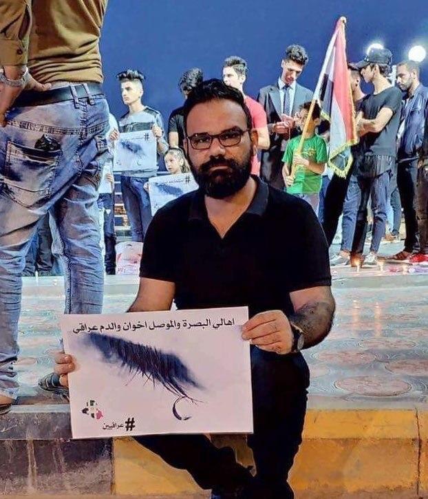 ب 21 طلقة بالتمام والكمال اغتيال الناشط تحسين اسامه امام محله بالجنينة بالبصرة