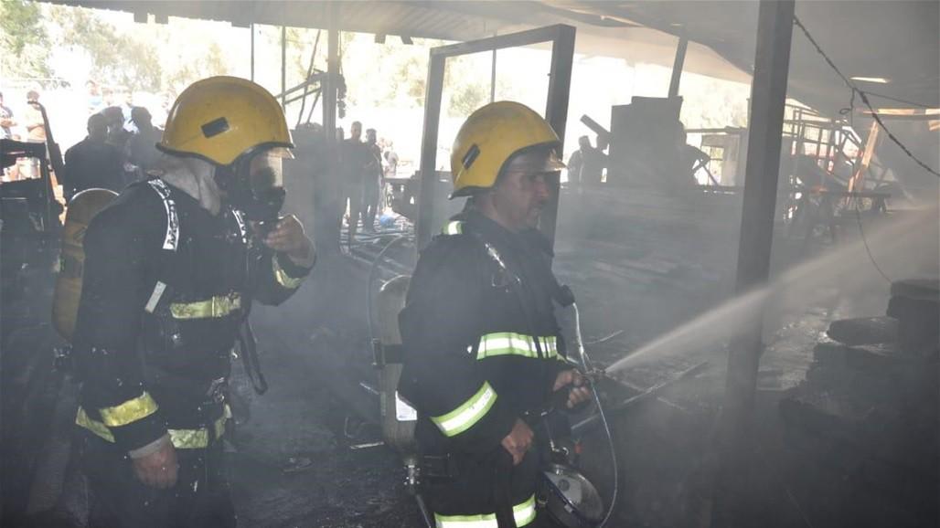 معمل للنجارة جنوبي بغداد يحترق